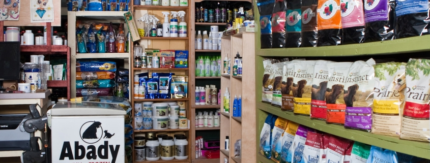 Shelves filled with pet food and supplies